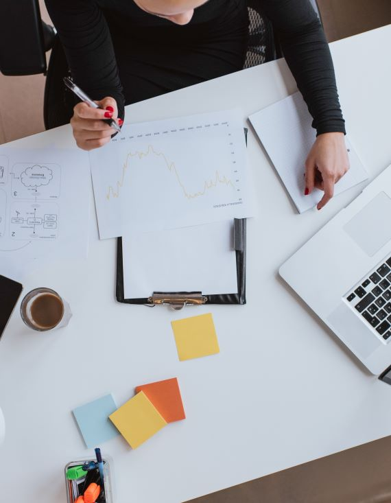 Marketer reviewing report metrics